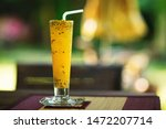 closeup glass of passion fruit... | Shutterstock . vector #1472207714