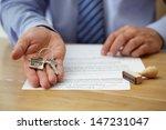 real estate agent handing over...   Shutterstock . vector #147231047