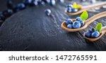 freshly picked blueberries on... | Shutterstock . vector #1472765591