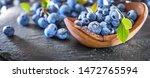 freshly picked blueberries on... | Shutterstock . vector #1472765594