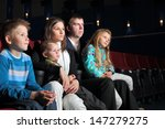family watching a movie in the... | Shutterstock . vector #147279275