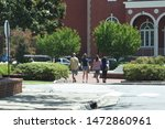 Stock photo an incoming freshman and her family tour a college campus 1472860961