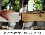 Small photo of rabbet or carpentry joints. carpenter using a circular saw to cut a spruce wooden beam for Carport outdoor construction. Woodworking and carpentry production. woodwork concept.