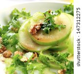 Waldorf salad.  Apples, walnuts, celery and curly lettuce. - stock photo
