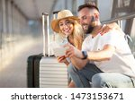 Couple using phone, making video call in airport, waiting for departure - stock photo