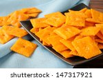 A Snack Dish Of Cheese Flavore...