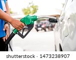 man refill and filling oil gas... | Shutterstock . vector #1473238907