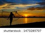 Silhouette Of Thai Fisherman...