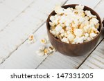 Fresh Popcorn In Bowl On White...