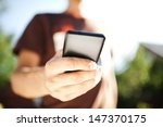close up of a man using mobile... | Shutterstock . vector #147370175
