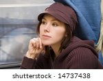 Small photo of Young woman travel in passenger roomette