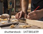hand of a carpenter taking