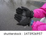 Black Gloves On The Snow Flakes