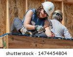 Carpenter Works On Building...
