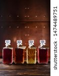 Small photo of Aromatic wines, liqueurs, tincture and spirits in elegant bottles, still life. set of tinctures in decanter