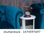 Small photo of Set of vintage upholstered sofa with florid ornament, carved wooden round table and telephone. Furniture for interior vintage style isolated
