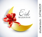 Muslim community festival Eid Mubarak background with golden moon wrapped in red ribbon.