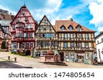 Small photo of Colorful half-timbered houses on the market place (Alter Marktplatz) in old german town Miltenberg am Main river. Odenwald, Bavaria, border with Hesse, Hessen. Germany