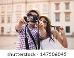 lovely couple taking photo of... | Shutterstock . vector #147506045