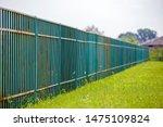 Long Rusty Old Metalic Fence.