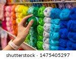 Close Up Of Yarn Balls. Girl...