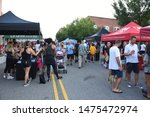 Small photo of Wake Forest, NC/United States- 08/09/2019: Vendors in tents solicit services and memberships to passerby at a music festival downtown.