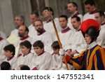 Small photo of VATICAN CITY, VATICAN - DECEMBER 31 : Unidentified Swiss Guard looks on as Pope John Paul II celebrates the Vespers and Te Deum prayers in Saint Peter's Basilica at the Vatican on December 31, 2004.