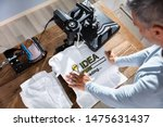 man printing image on t shirt... | Shutterstock . vector #1475631437