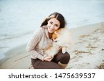 Stock photo beautiful young woman and little spitz dog 1475639537
