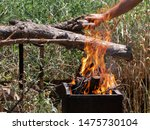 Men\'s Is Making A Fire From Wood