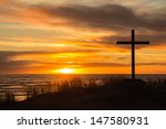 Cross On A Sand Dune With A...