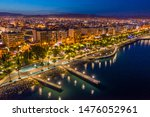 Small photo of Republic of Cyprus. Night view of Limassol. Lit at night the streets of Limassol. Top view of Cyprus. Holidays in Cyprus. Piers and quay. A pedestrian pier leads to the sea.