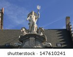 Neptune statue on the house in Gent, Belgium  - stock photo