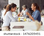 Stock photo friends having fun in a restaurant or cafeteria coffee shop young business people during a break 1476205451