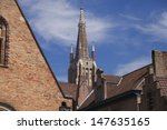 The Saint Salvador Cathedral in Bruges and roofs of old houses  - stock photo