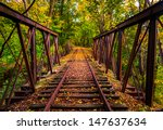 Railroad Tracks Covered In...