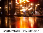 Stock photo empty real wood table top with light reflection on scene at restaurant pub or bar at night 1476393014
