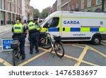 Small photo of 13th July 2019, Dublin, Ireland. Garda van and bike gardai close off a street to facilitate a protest march in Dublin city centre.