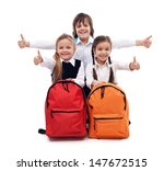 Back to school concept with happy kids giving thumbs up sign - isolated - stock photo