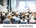 Small photo of Audience at the conference hall. Male speaker giving a talk in conference hall at business event. Business and Entrepreneurship concept. Focus on unrecognizable people in audience.
