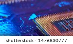 Small photo of CPU desktop with the contacts facing up lying on the motherboard of the PC. the chip is highlighted with blue light. Technology background