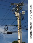 A Utility Pole With Many Wires...
