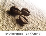 coffee grains on a rough sacking | Shutterstock . vector #14772847