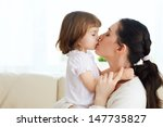 happy mother holding her child | Shutterstock . vector #147735827