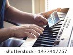 Man Watching Piano Tutorial...