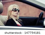 blond woman driving a... | Shutterstock . vector #147754181