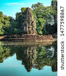 Small photo of Neak Pean temple Standing in the water of the deep Forrest