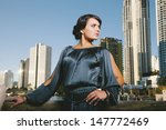 pretty young lady in the city - stock photo