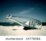 Bottle With Ship Inside Lying...