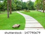 walkway on green grassy in park. | Shutterstock . vector #147790679